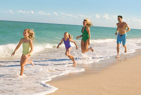 Happy Family Playing On the Beach | Bluegreen Vacations